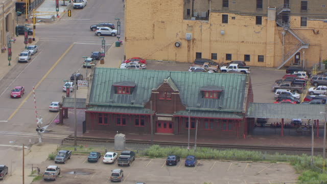 MS AERIAL TS ZO Shot of Old Soo Line Depot and pull out to downtown / Minot, North Dakota, United States