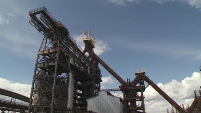 ms shot of old steelworks / uckange, lorraine, france - lorraine bildbanksvideor och videomaterial från bakom kulisserna
