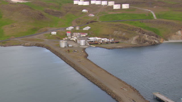 ms aerial shot of old whaling base company at bank of bay / iceland - valfångst bildbanksvideor och videomaterial från bakom kulisserna