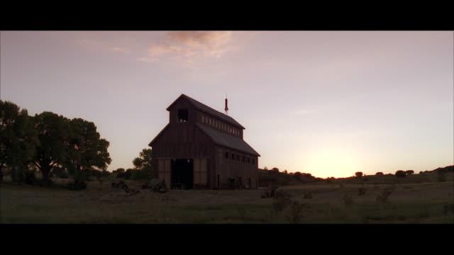 ws shot of older wooden barn / unspecified - open field stock videos & royalty-free footage