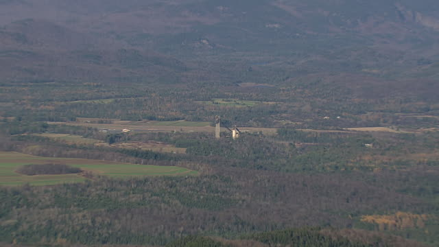 ws aerial zi zo pan shot of olympic ski jumps and cityscape at lake placid / new york, united states - freistil skifahren stock-videos und b-roll-filmmaterial