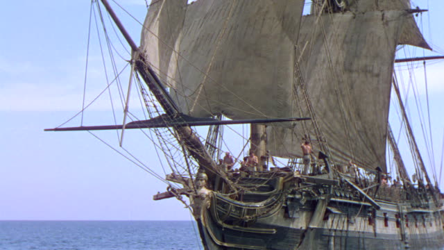 ms ts shot of one clipper ship deck to crew at work with moving in to ocean - cannon stock videos & royalty-free footage