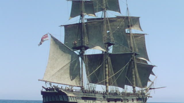 ws shot of one clipper ship moving in ocean - nave a vela video stock e b–roll