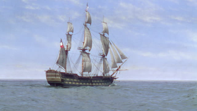 ws shot of one clipper ship moving in to ocean - 帆船点の映像素材/bロール