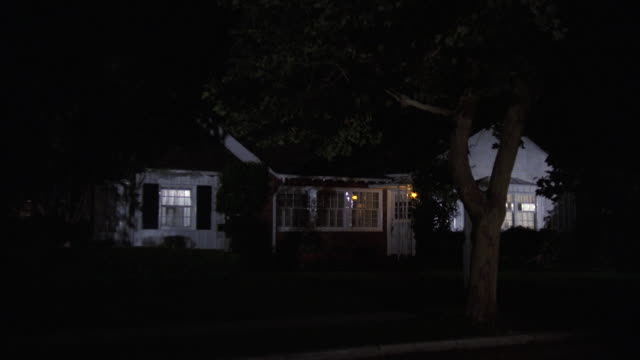 ms zi zo shot of one story california ranch style house with lights on at night - ranch house stock videos & royalty-free footage