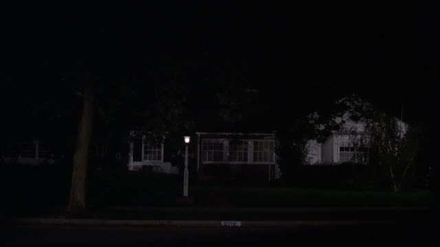 ms shot of one story california ranch style house with lights on at night - ranch house stock videos & royalty-free footage
