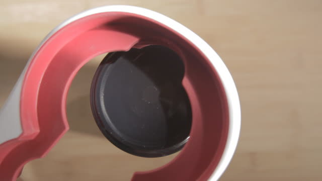 CU Shot of Opening of jar with help of jar opener / Los Angeles, California, United States