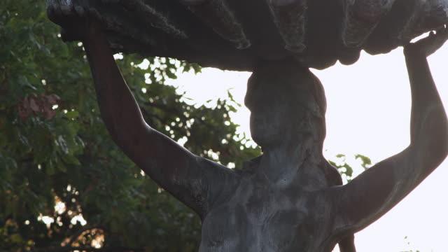 ecu shot of opera fountain / riga, latvia - female likeness stock videos & royalty-free footage