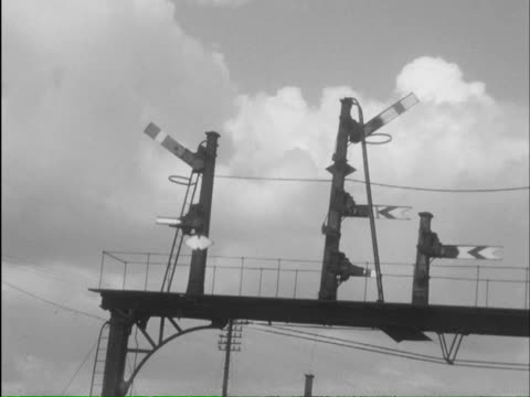 ms shot of operating switchboard, signals changing and man operating levers / lickey, worcestershire, england - nur männer über 40 stock-videos und b-roll-filmmaterial