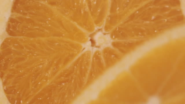 ECU SLO MO Shot of Orange being cut / Toronto, Ontario, Canada
