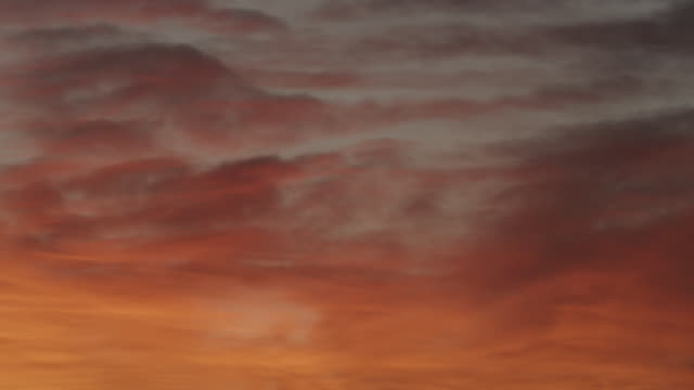 ms shot of orange clouds at sunset with grey sky / roswell, new mexico, united states - roswell stock videos & royalty-free footage