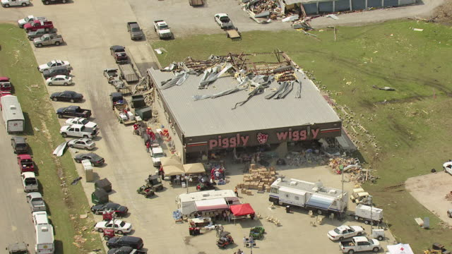 ms aerial shot of orbit around piggly wiggly with roof torn off and parking lot / smithville, mississippi, united states - damaged stock videos & royalty-free footage
