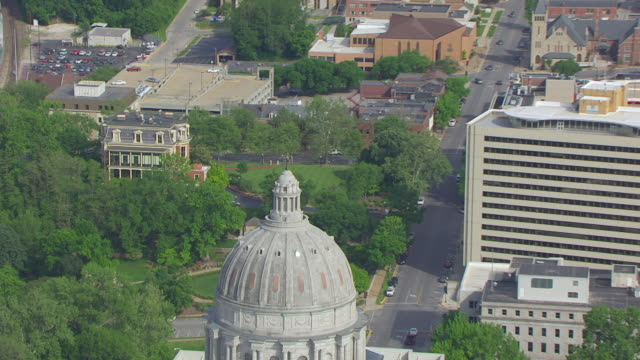 CU AERIAL ZO DS TS Shot of orbit dome Ceres statue on top of Missouri State Capitol and downtown / Jefferson City, Missouri, United States