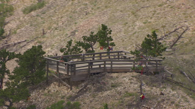 MS AERIAL TS ZO Shot of orbit man on look out point at top of Bear Butte in Meade County / South Dakota, United States
