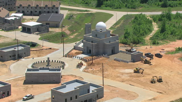 MS AERIAL Shot of orbit Middle Eastern practice village with buildings made of cement and mosque / Mississippi, United States