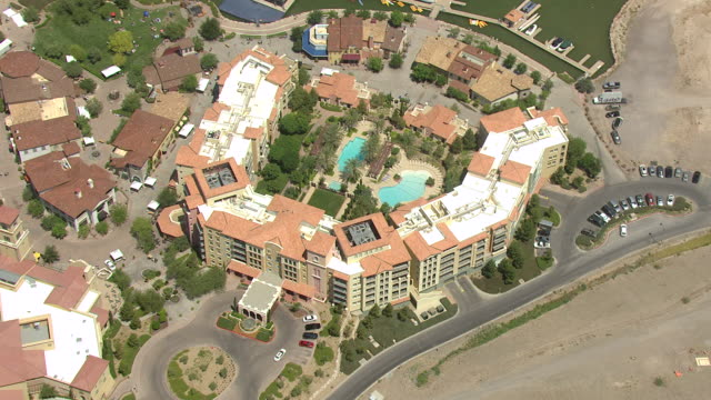 MS AERIAL DS Shot of orbit over development with swimming pools and residences / Henderson, Nevada, United States