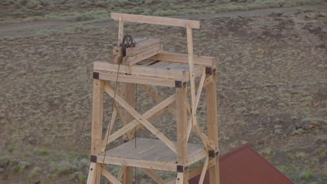 cu aerial ts ds shot of orbit pulley at south pass historical site to reveal buildings / wyoming, united states  - wyoming stock videos & royalty-free footage