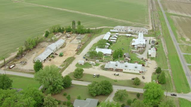 ms aerial td shot of orbit shack up inn sharecropper shacks with landscape / clarksdale, mississippi, united states - sharecropper stock videos & royalty-free footage