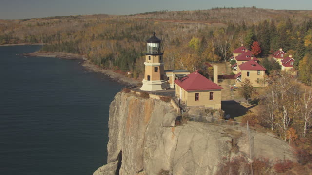 MS AERIAL Shot of orbit Split Rock Lighthouse with group of people outside / Minnesota, United States