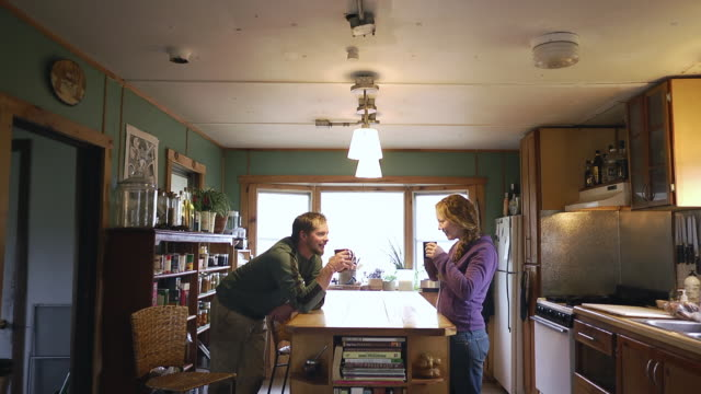 MS SLO MO Shot of Organic farm couple having coffee and discussion in morning with smiling / Chatham, Michigan, United States
