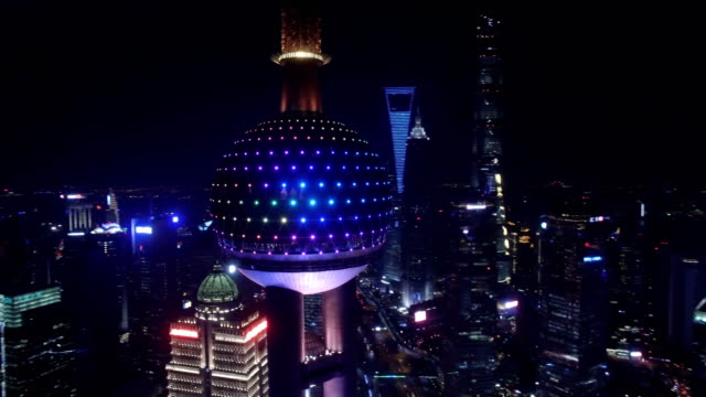aerial shot of oriental pearl tv tower and cityscape at night/shanghai,china - lujiazui stock videos & royalty-free footage