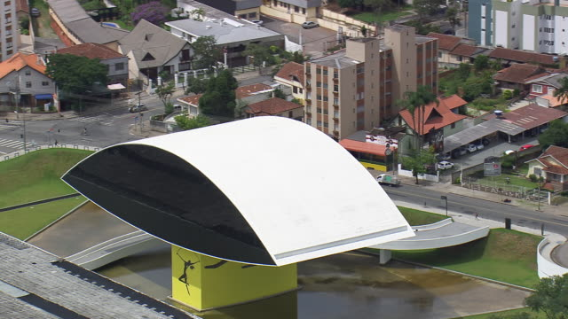 ms aerial shot of oscar niemeyer museum / parana, brazil - oscar niemeyer stock videos and b-roll footage