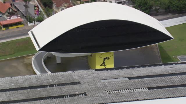 cu aerial zo ts shot of oscar niemeyer museum surrounding area / parana, brazil - oscar niemeyer stock videos and b-roll footage