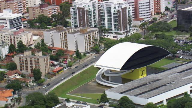 ms aerial shot of oscar niemeyer museum surrounding area / parana, brazil - oscar niemeyer stock videos and b-roll footage