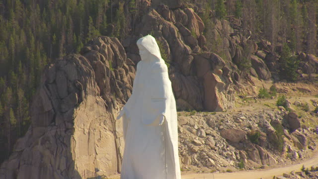ms aerial shot of our lady of the rockies statue in mountain side / butte, montana, united states - butte montana stock videos & royalty-free footage