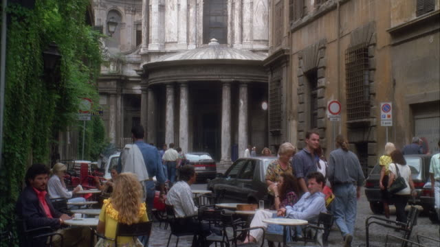stockvideo's en b-roll-footage met ms pan tu shot of outdoor cafe with palazzo buildings at cobblestone street - 1992