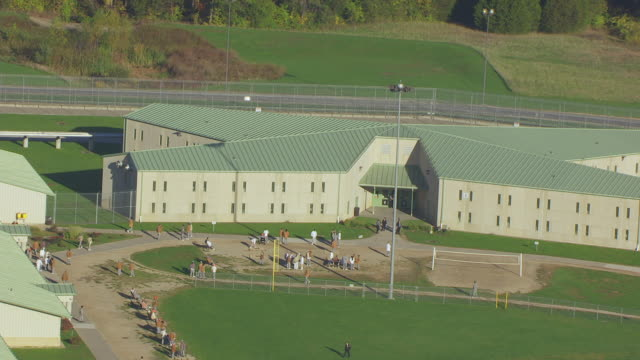 ms aerial ts zo shot of outside in courtyard at potosi correctional facility / missouri, united states - prison building stock videos & royalty-free footage