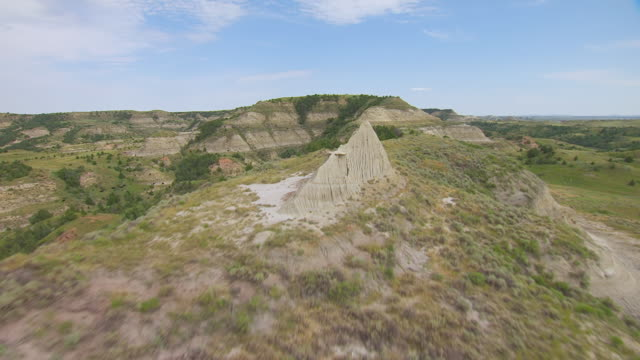 MS AERIAL TU Shot of Over badlands ridge in Theodore Roosevelt National Park / North Dakota, United States