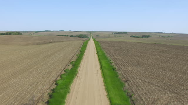 CU AERIAL LA TU Shot of Over dirt road to reveal road to horizon / Nebraska, United States