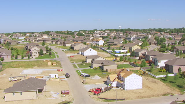 ms aerial tu la shot of over green field to reveal neighborhood and town southwest of omaha / nebraska, united states - nebraska stock-videos und b-roll-filmmaterial