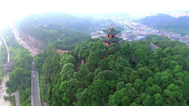 WS AERIAL shot of pagoda on hilltop nearby nearby Langzhong ancient town/Sichuan, China