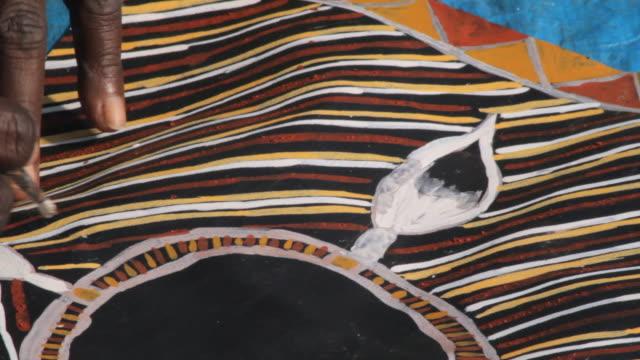 cu shot of painting of aboriginal tiwi art / northern territory, australia - australian aborigine culture stock videos & royalty-free footage