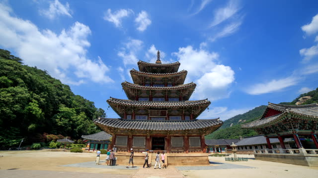 shot of palsangjeon(wooden pagoda, korea national treasure 55, joseon) and clouds against blue sky in beopjusa(temple) - circa 5th century stock videos & royalty-free footage