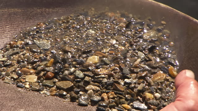 cu zi zo shot of panning for gold at el dorado gold mine / fox, alaska, united states - panning stock videos & royalty-free footage