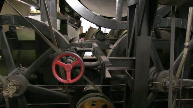 ms shot of paper built machine in paper mill / gmund, bavaria, germany - paper mill stock videos and b-roll footage