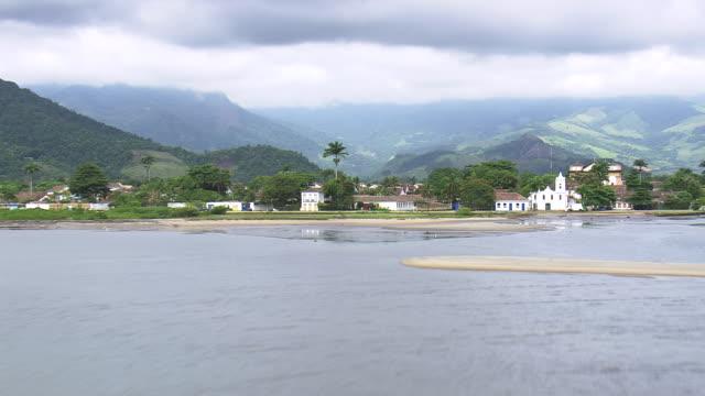 ws aerial shot of paraty town near ocean / sao paulo, brazil - brazil stock videos & royalty-free footage
