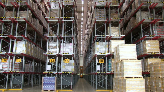 ms shot of parcels storage and forklift at warehouse of catalog company / grossostheim, bavaria, germany - storage compartment stock videos and b-roll footage