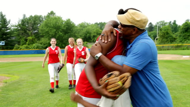 MS PAN Shot of Parent congratulates daughter after softball game / Albany, New York, United States