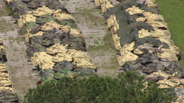 CU AERIAL Shot of parked tanks at military post Camp Shelby in broad day light / Mississippi, United States
