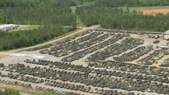 ms aerial zo shot of parking lot full of military trucks at camp shelby campus / mississippi, united states - barracks stock videos & royalty-free footage