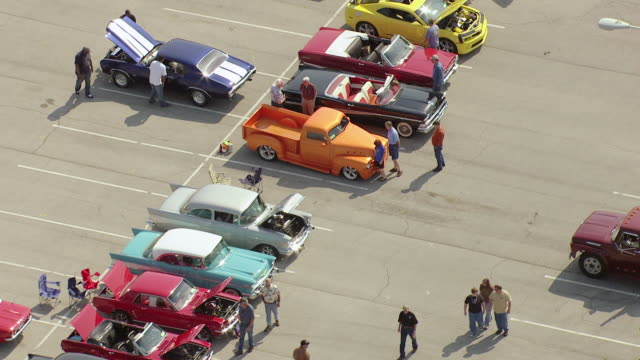 ms aerial shot of parking lot with people admiring cars at blue suede cruise / tupelo, mississippi, united states - motor show stock videos and b-roll footage