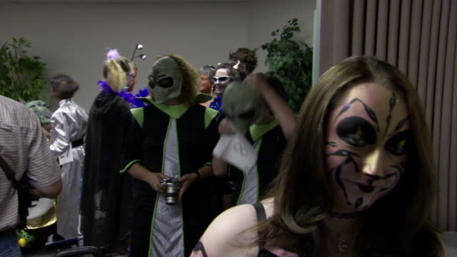 ms pan shot of participants getting ready backstage for roswell ufo festival costume contest / roswell, new mexico, united states - roswell stock videos & royalty-free footage