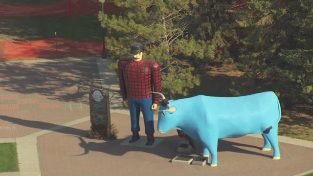 cu aerial shot of paul bunyan and babe statues / bemidji, minnesota, united states - roadside stock videos and b-roll footage