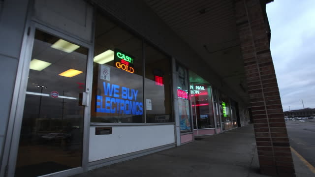 MS R/F Shot of Pawn shop window with neon lights / Binghamton, New York, United States