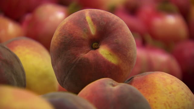ecu tu shot of peaches stacked / sydney, new south wales, australia - peach stock videos & royalty-free footage