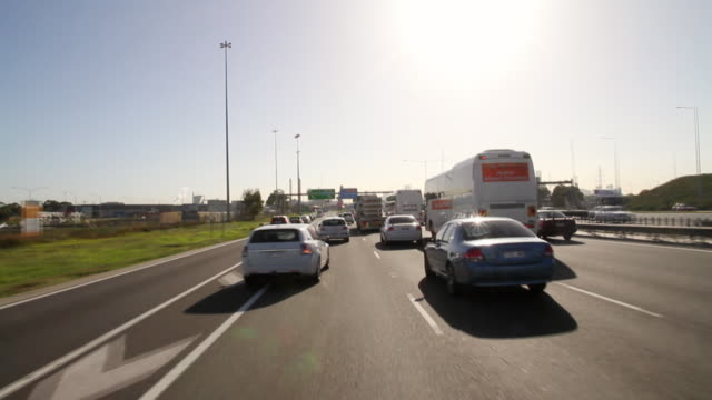 ms t/l pov shot of peak hour traffic on freeway crossing westgate bridge / melbourne, victoria, australia - victoria australia stock videos & royalty-free footage